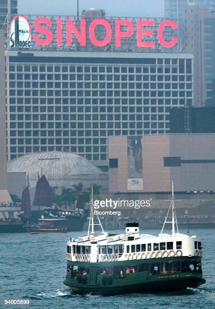 The Star ferry sails on the harbour past a Sinopec neon sign in Hong Kong China Monday October 30 2006 China Petroleum Chemical Corp Asia's biggest...