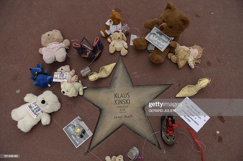 The star of German actor Klaus Kinski is surrounded with dolls and a sign reading 'Thanks Klaus, it doesn't hurt anymore' in Berlin, on February 10, 2013. The action aims to call attention to the allegations against Klaus Kinski to have repeatedly raped his daughter. Actress Nastassja Kinski accused her father of attempting to abuse her, following allegations by her half-sister Pola that he raped her throughout her childhood.
