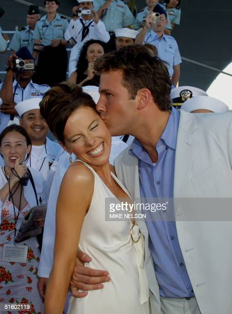 The star of the movie 'Pearl Harbor' Ben Affleck kisses his costar Kate Beckinsale as US Navy personnel applaud as they arrive for the world premiere...