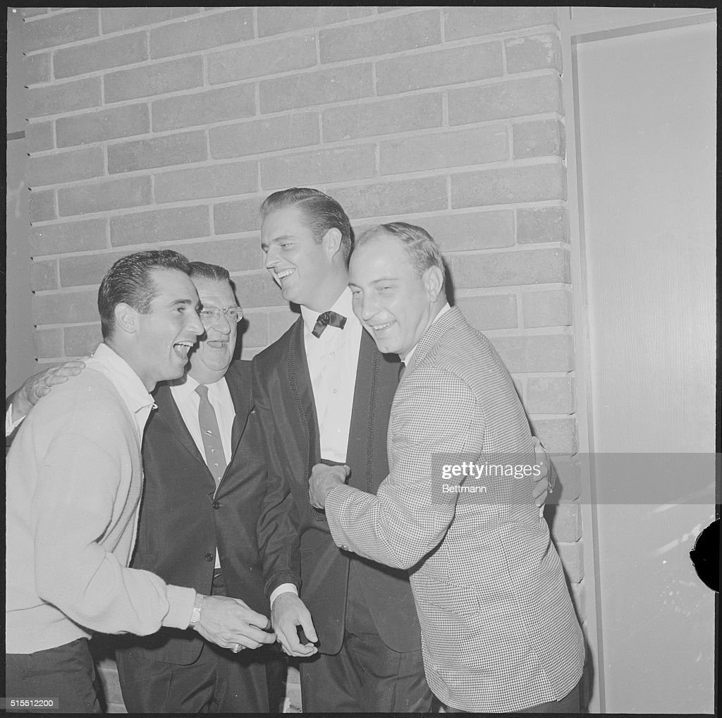 The star pitchers of the Los Angeles Dodgers gather around their boss, Dodger owner Walter O'Malley (center), at the Dodger Victory Party after winning the fourth and final game of the World Series. Left to Right: Sandy Koufax, O'Malley, Don Drysdale, and John Podres pitched the Dodgers to Series victory over the New York Yankees in a four game sweep in 1963.