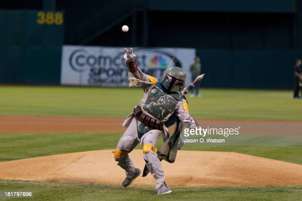 The Star Wars character Boba Fett throws out the ceremonial first pitch before the game between the Oakland Athletics and the Minnesota Twins at Oco...