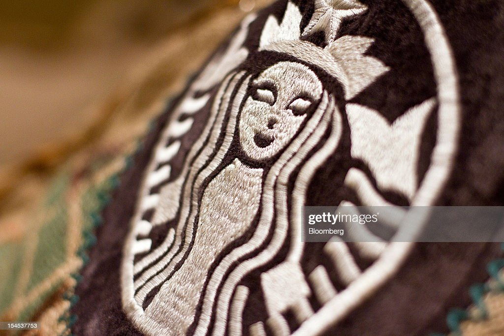 The Starbucks Corp. logo is displayed inside the company's first India outlet in Mumbai, India, on Friday, Oct. 19, 2012. Starbucks, which opened its first store in India today, will maintain its partnership with Tata Global Beverages Ltd. and plans to take some of that company's products to new markets, Starbucks' Chief Executive Officer Howard Schultz said. Photographer: Dhiraj Singh/Bloomberg via Getty Images