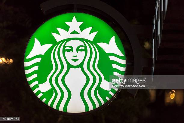 DOWNTOWN TORONTO ONTARIO CANADA The Starbucks logo featuring a woman wearing crown against green background Starbucks Corporation doing business as...