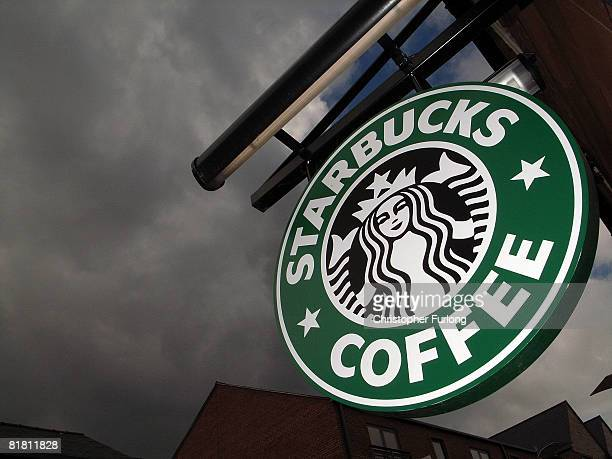 The Starbucks logo hangs outside one of the company's cafes in Northwich on 3 July 2008 in Northwich England Starbucks Corp in the US recently...
