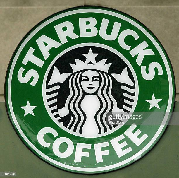 The Starbucks's coffee logo is displayed June 2 2003 outside a Starbucks coffee shop at Dupont Circle in Washington DC Starbucks introduced a new...