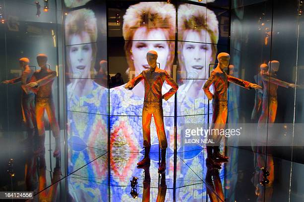 The 'Starman' costume from David Bowie's appearance on 'Top of the Pops' in 1972 is displayed at the 'David Bowie is' exhibition at the Victoria and...