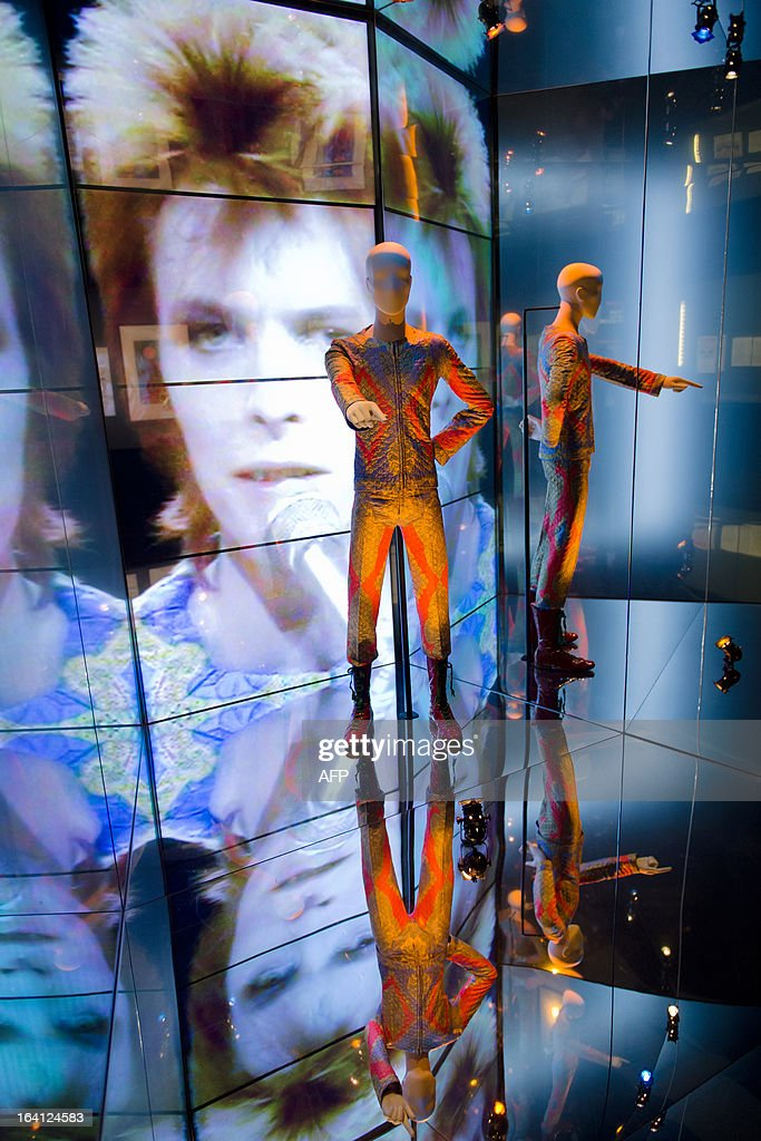 The 'Starman' outfit from David Bowie's appearance on 'Top of the Pops' in 1972 is displayed at the 'David Bowie is' exhibition at the Victoria and Albert (V&A) museum in central London on March 20, 2013. Running March 23 to August 11, the exhibition features more than 300 objects that include handwritten lyrics, original costumes, fashion, photography, film, music videos, set designs and Bowie's own instruments. AFP PHOTO/Leon Neal