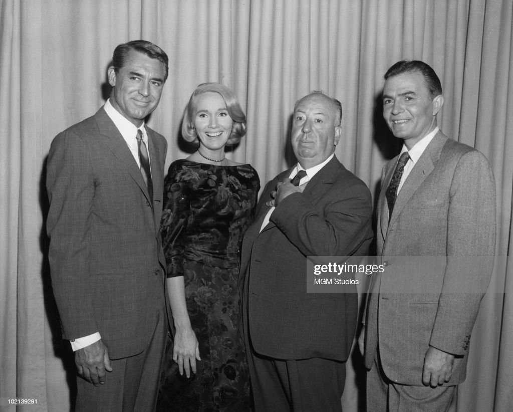 The stars and director of the film 'North By Northwest', 1959. From left to right, Cary Grant (1904 - 1986), Eva Marie Saint, director Alfred Hitchcock (1899 - 1980) and James Mason (1909 - 1984).