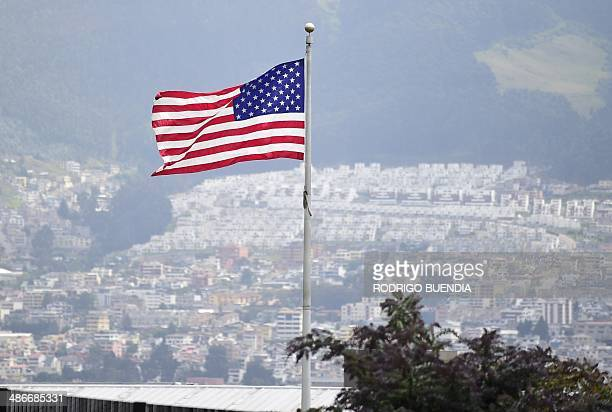 The Stars and Stripes waves over the US Embassy to Ecuador compound in Quito on April 25 2014 Around 20 military and security personnel from the...