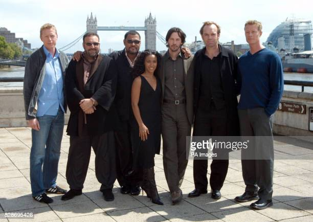 The stars and the producer of Matrix Reloaded from left to right actor Neil Rayment producer Joel Silver actor Laurence Fishburne actress Jada...