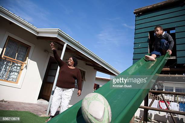 The Stars Foundation visiting Home from Home in Cape Town South Africa Doris and one of her children by their house Home from Home provide security...