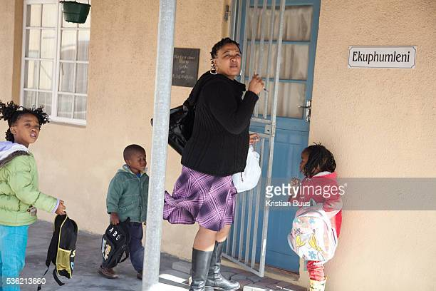 The Stars Foundation visiting Home from Home in Cape Town South Africa Priscilla foster mother in Khayelitsha township arriving home with some of her...