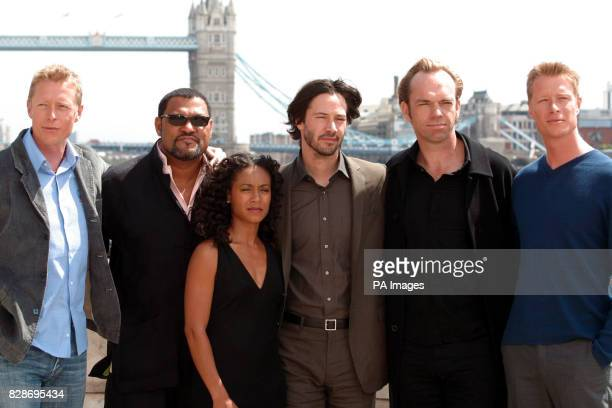 The stars of Matrix Reloaded from left to right actor Neil Rayment actor Laurence Fishburne actress Jada PinkettSmith actor Keanu Reeves actor Hugo...