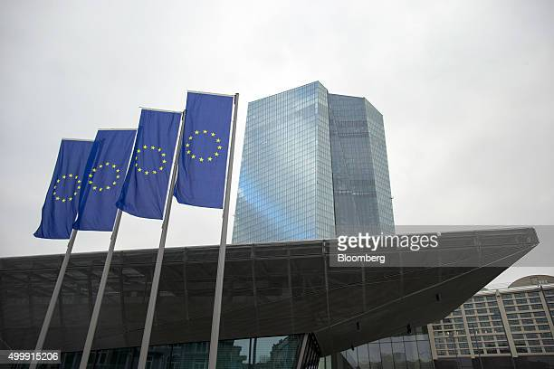 The stars of the European Union sit on banners flying outside the European Central Bank headquarters in Frankfurt Germany on Thursday Dec 3 2015...