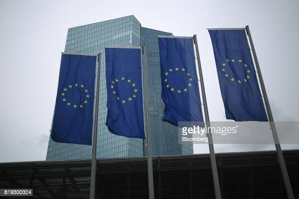 The stars of the European Union sit on banners flying outside the European Central Bank headquarters in Frankfurt Germany on Thursday July 20 2017...