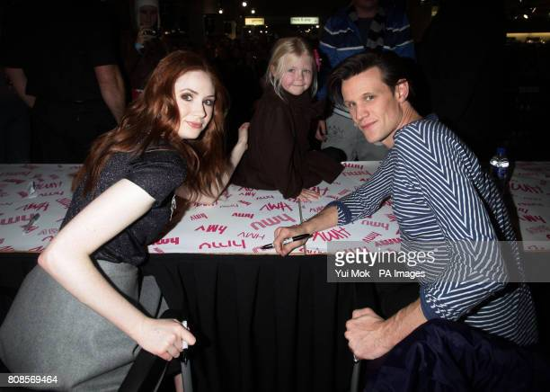 The stars of the show Matt Smith and Karen Gillan with Ashleigh Goodwin aged five during an instore signing for the DVD boxset of BBC1 TV show Dr Who...