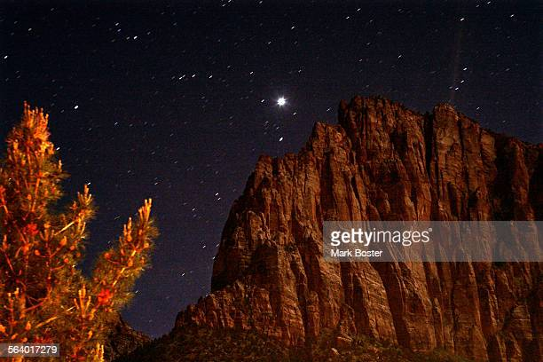 –The stars shine over the red rocks of Zion National Park during a 32–second exposure Utah Senator Bob Bennett has proposed a bill that would require...