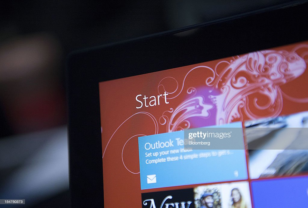 The 'Start' icon is displayed on a Microsoft Corp. Surface tablet computer during an event in New York, U.S., on Thursday, Oct. 25, 2012. Microsoft Corp. will be constrained in a contest against Apple Inc. in the market for handheld computers by unveiling a tablet that doesn't work with some of the most widely used downloadable applications. Photographer: Scott Eells/Bloomberg via Getty Images