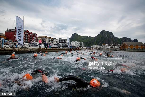 The start of The Arctic Triple // Lofoten Triathlon Olympic distance on August 18 2017 in Svolvar Norway Lofoten Triathlon is one of three races...
