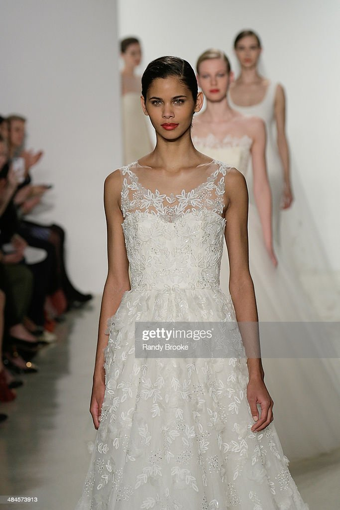 The start of the finale on the runway during the Amsale Spring 2015 Bridal collection show at EZ Studios on April 12, 2014 in New York City.