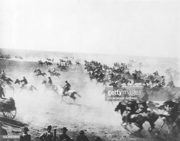 The start of the Oklahoma Land Run at high noon as settlers rush to claim the Unassigned Lands Oklahoma April 22 1889