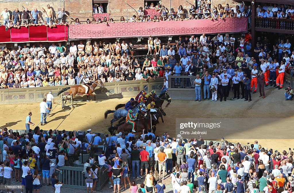 The start of the second rehearsal for the Palio known as the Prova on August 14, 2013 in Siena. The so-called Tratta, in which the ten horses are allocated to the varying city districts or contrada is a precursor to the Palio di Siena, a twice annual summer event, in which riders representing city districts compete, in a tradition that dates back to 1656.