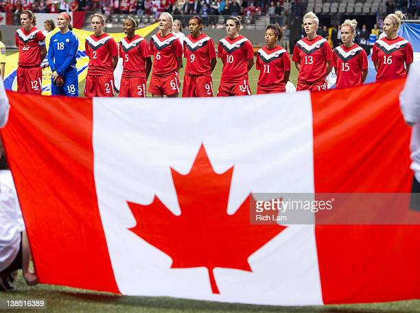 The starting 11 of team Canada listens to the national anthem prior to the start of the championship match of the 2012 CONCACAF Women's Olympic...