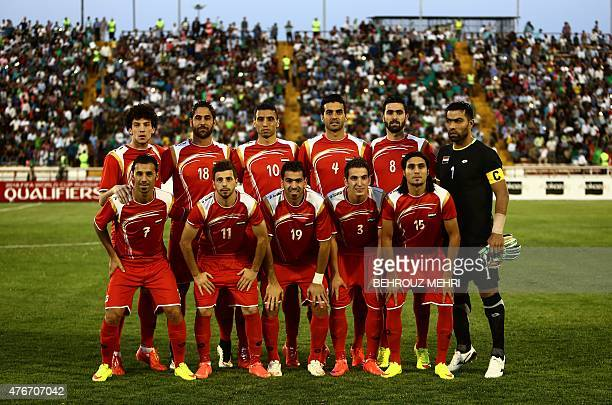 The starting eleven for Syria pose for a group picture prior to their 2018 World Cup qualifying group E football match against Afghanistan at Samen...