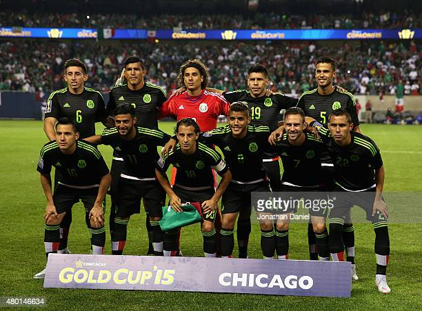 The starting eleven players for Mexico pose before a match in the 2015 CONCACAF Gold Cup against Cuba at Soldier Field on July 9 2015 in Chicago...