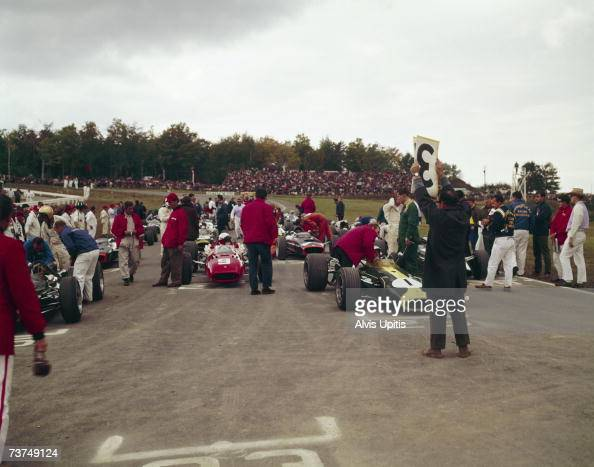 The starting grid gets the time sign before the start of the 1966 United States Grand Prix at Watkins Glen NY Lorenzo Bandini is in his red Ferrari...
