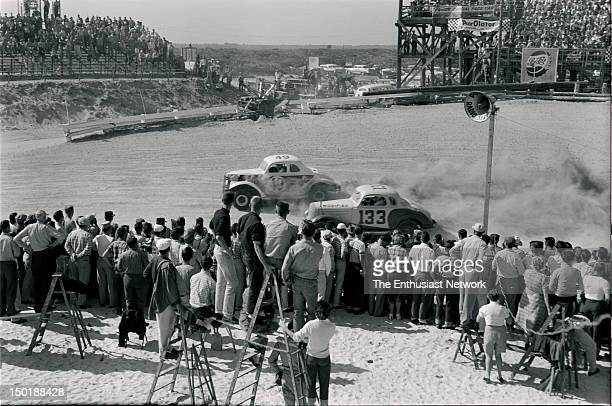 The starting grid readies for the start of the 125 mile beach and road course Modified race Vince Conrad is about to be passed by Curtis Turner...