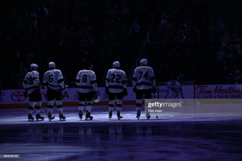 The starting line up for the Los Angeles Kings stand on the ice prior to the singing of the National Anthem before the game against the Columbus Blue...