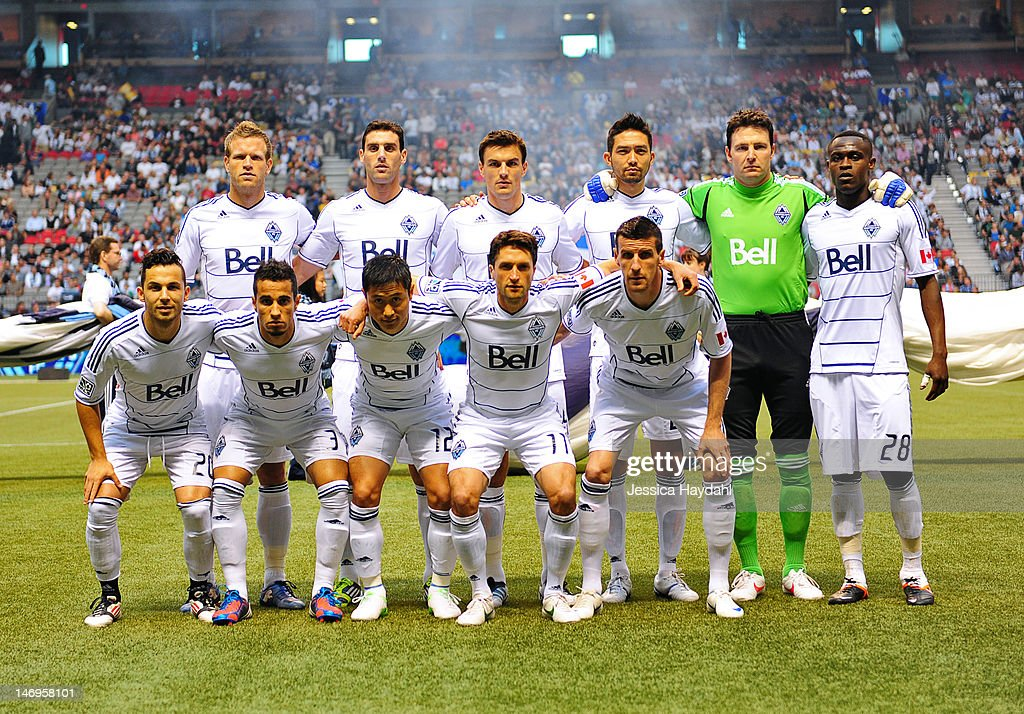 The starting line up for the Vancouver Whitecaps Back row Jay DeMerit Martin Bonjour Alain Rochat Jun Marques Davidson Joe Cannon and Gershon Koffie...