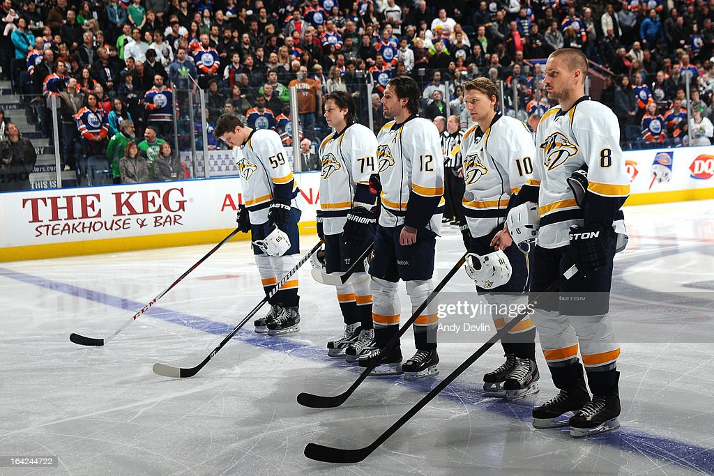 The starting line up of the Nashville Predators stands for the singing of the national anthem prior to a game against the Edmonton Oilers on March 17, 2013 at Rexall Place in Edmonton, Alberta, Canada.
