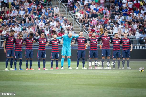 The starting line up of the US Men's National Team take part in a moment of silence to honor Tony DiCicco US Women's Head Coach that recently passed...