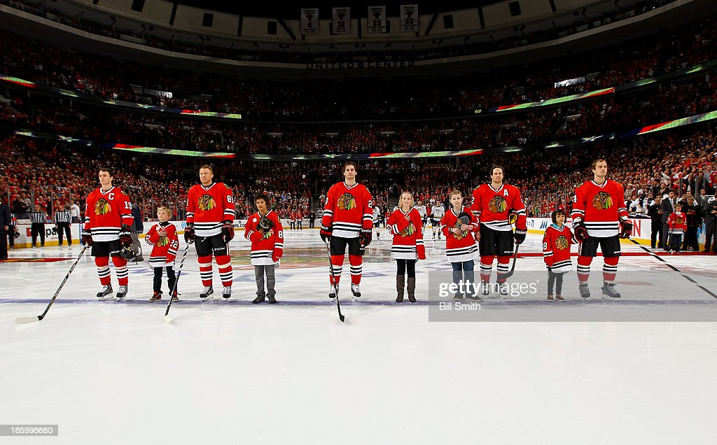 The starting line-up for the Chicago Blackhawks, Jonathan Toews #19, Marian Hossa #81, Brandon Saad #20, Duncan Keith #2 and Niklas Hjalmarsson #4, stand with children from the Make-a-Wish foundation before the NHL game against the Nashville Predators on April 07, 2013 at the United Center in Chicago, Illinois.