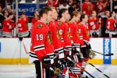 The starting lineup for the Chicago Blackhawks Jonathan Toews Marian Hossa Brandon Saad Niklas Hjalmarsson and Duncan Keith stand for the National...