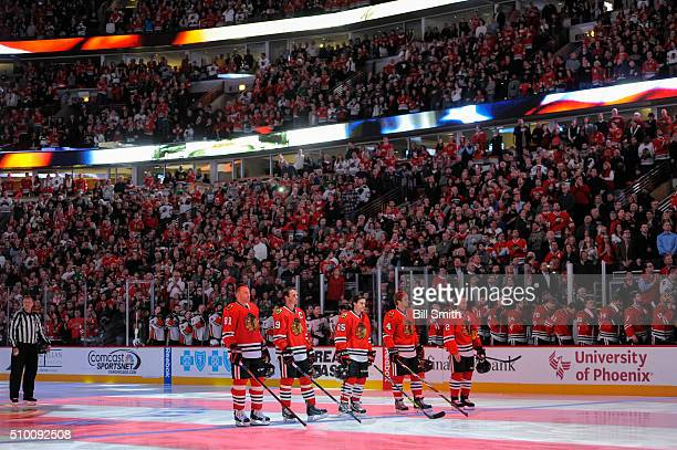 The starting lineup for the Chicago Blackhawks Marian Hossa Jonathan Toews Andrew Shaw Niklas Hjalmarsson and Duncan Keith stand for the national...