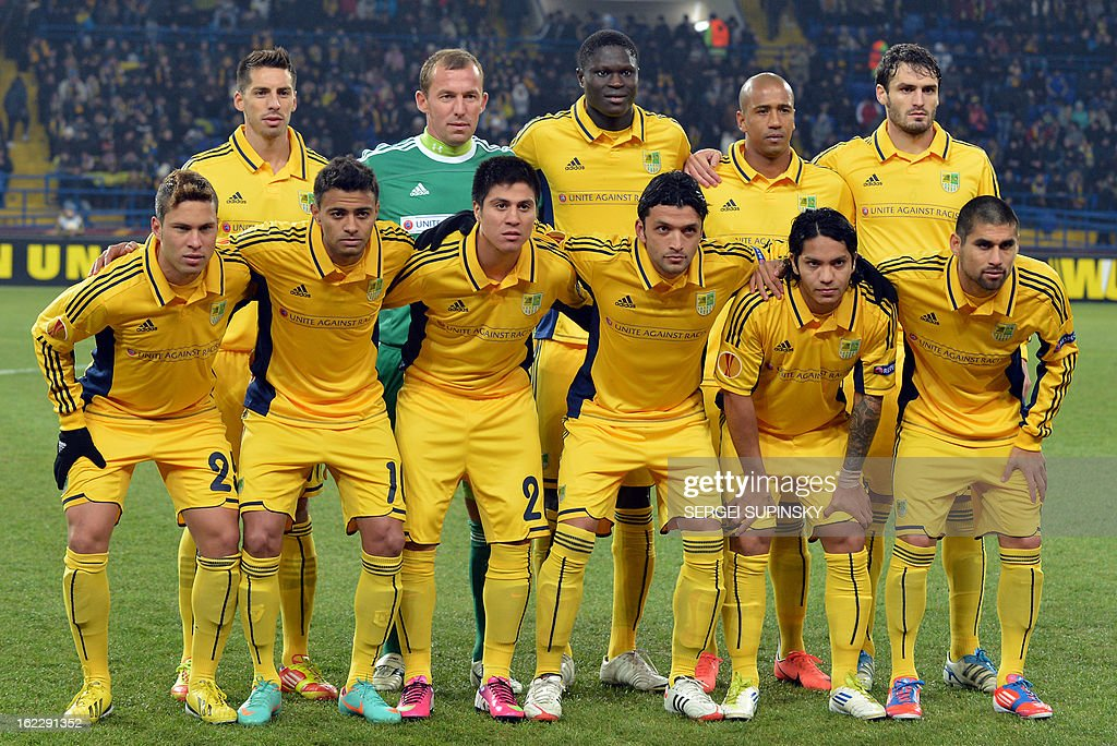 The starting lineup of FC Metalist pose prior UEFA Europa League, Round of 32, football match with FC Newcastle United on February 21, 2013.