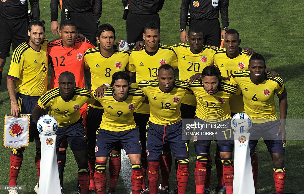 The starting line-up of the Colombia national football team poses for photographers before the start of their 2011 Copa America quarter-final football match against Peru held at the Mario Kempes stadium in Cordoba, 770 Km northwest of Buenos Aires, on July 16, 2011. (Lto R 2nd row) Mario Yepes, Luis Martinez, Abel Aguilar, Freddy Guaín, Cristian Zapata and Luis Amaranto Perea. (L to R 1st row) Pablo Armero, Falcao Garcia, Camilo Zuniga, Dayro Moreno and Carlos Sanchez.