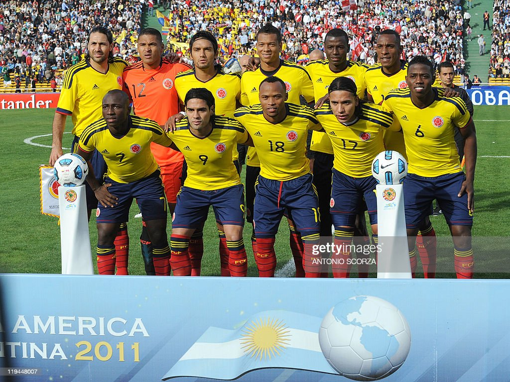 The starting line-up of the Colombian national football team poses for photographers before the start of their 2011 Copa America quarter-final football match against Peru held at the Mario Kempes stadium in Cordoba, 770 Km northwest of Buenos Aires, on July 16, 2011. (Lto R 2nd row) Mario Yepes, Luis Martinez, Abel Aguilar, Freddy Guaín, Cristian Zapata and Luis Amaranto Perea. (L to R 1st row) Pablo Armero, Falcao Garcia, Camilo Zuniga, Dayro Moreno and Carlos Sanchez.