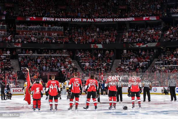 The starting lineup of the Ottawa Senators during the singing of the national anthems prior to a game against the Pittsburgh Penguins in Game Three...