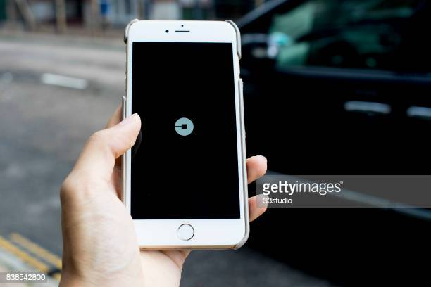 The startup screen app of Uber a car transportation mobile app developed by the American technology company Uber Technologies Inc is pictured on the...