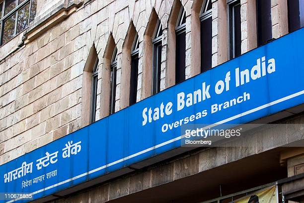 The State Bank of India building stands in Kolkata India on Monday March 14 2011 India faces pressure to step up its battle against price gains even...