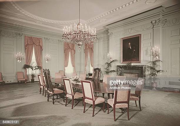 The State Dining Room in the White House Washington DC circa 1962 A portrait of President Abraham Lincoln by George PA Healy hangs above the fireplace