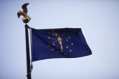 The state flag flies over the Indiana State House in Indianapolis Indiana US on Sunday May 20 2012 The Indiana agency that supervised February's...