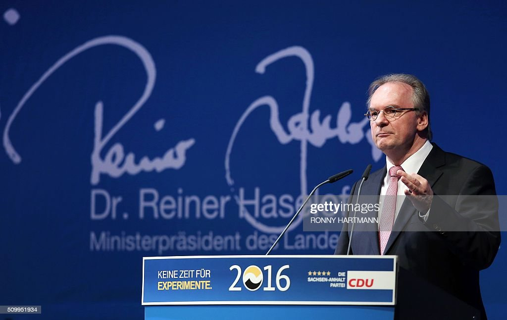 The State Premier of the federal state of Saxony-Anhalt, Reiner Haseloff speaks during the launch of the election campaign of the Christian Democratic Union (CDU) party for state elections in Magdeburg, eastern Germany, on February 13, 2016. Regional elections in three German federal states - Saxony-Anhalt, Rhineland Palatinate and Baden-Wuerttemberg - will take place on March 13, 2016. / AFP / Ronny Hartmann