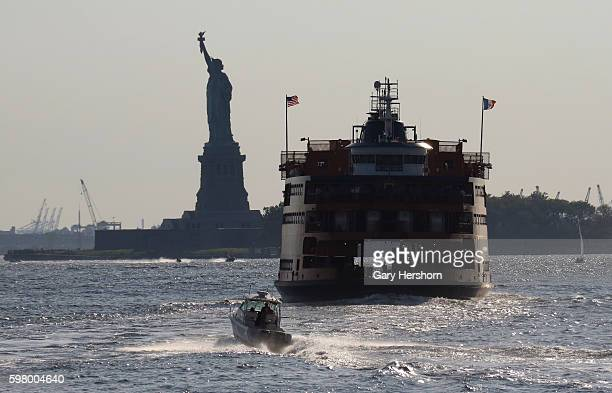 The Staten Island ferry makes its way past the Statue of Liberty on August 27 2016 in New York City
