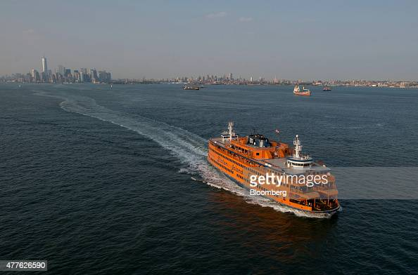 The Staten Island Ferry moves across the Upper Bay in this aerial photograph taken above New York US on Wednesday June 10 2015 US stocks rallied and...