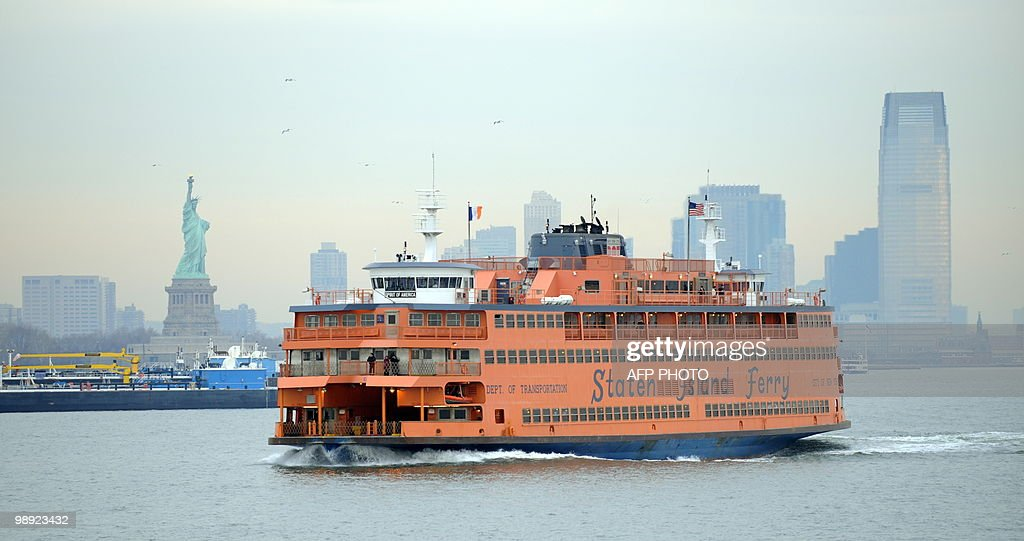 The Staten Island Ferry passes the Statue of Liberty as it makes it's ways south from Manhattan to Staten Island on January 15 2010 in New York...